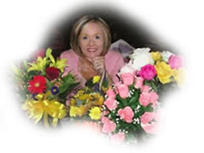 Janice Mortlock surrounded by flowers